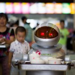 TO GO WITH STORY: CHINA -ROBOTS BY TOM HANCOCK This photo taken on August 13, 2014, shows a robot, carrying food to the customers in the robot restaurant in Kunshan. The robot restaurant opened on August 2, 2014 and the robots function as cooking machines, doormen and waiters.