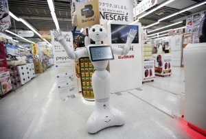 "SoftBank Corp's human-like robot named ""Pepper"" gestures as it introduces Nestle's coffee machines at an electric shop in Tokyo December 1, 2014. Nestle SA started to use robots to help sell its coffee makers at electronics stores across Japan, becoming the first corporate customer for the chatty, bug-eyed androids unveiled in June by tech conglomerate SoftBank Corp. The waist-high robot, developed by a French company and manufactured in Taiwan, was touted by Japan's SoftBank as capable of learning and expressing human emotions, and of serving as a companion or guide in a country that faces chronic labour shortages. The maker of Nescafe coffee and KitKat chocolate bars plans to have the robots working at 1,000 stores by the end of next year, a Nestle official said. REUTERS/Issei Kato (JAPAN - Tags: SCIENCE TECHNOLOGY SOCIETY BUSINESS TPX IMAGES OF THE DAY) *** Local Caption *** Robot mirip manusia bernama ""Pepper"" buatan SoftBank Corp memperkenalkan mesin kopi Nestle di sebuah toko elektronik di Tokyo, Jepang, Senin (1/12). Nestle SA mulai menggunakan robot untuk membantu penjualan mesin kopi mereka di toko-toko elektronik di Jepang, menjadi pelanggan korporat pertama yang menggunakan android cerewet yang diluncurkan bulan Juni lalu oleh konglomerat teknologi SoftBank Corp. Menurut SoftBank, robot yang dikembangkan oleh sebuah perusahaan Perancis dan dibuat di Taiwan itu memiliki kemampuan untuk belajar dan memperlihatkan emosi manusia, serta dapat menjadi teman atau pemandu di negara yang menghadapi kekurangan tenaga kerja. Pembuat kopi Nescafe dan coklat KitKat itu berencana untuk memiliki robot yang bekerja di 1.000 toko pada akhir tahun depan, kata seorang pejabat Nestle."
